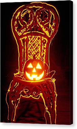 Carved Smiling Pumpkin On Chair Canvas Print by Garry Gay
