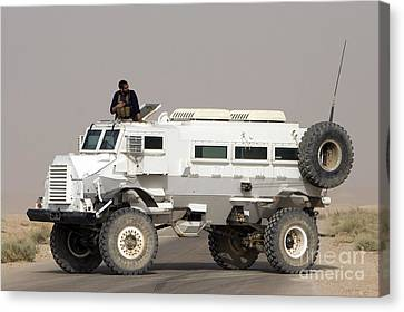 Casper Armored Vehicle Blocks The Road Canvas Print by Terry Moore