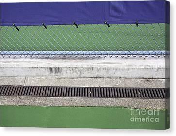 Chain Link Fence On Tennis Courts Canvas Print by Paul Edmondson