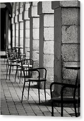 Chairs And Pillars  Canvas Print by Marcio Faustino