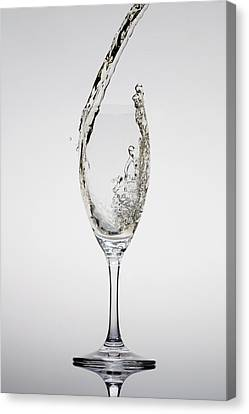 Champagne Being Poured Into A Glass Canvas Print by Dual Dual