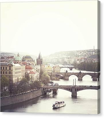 Charles Bridge Crossing Vltava River Canvas Print by Image - Natasha Maiolo