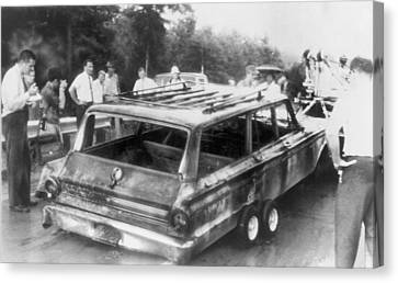 Charred Remains Of Station Wagon Driven Canvas Print by Everett