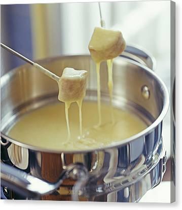 Cheese Fondue Canvas Print by David Munns