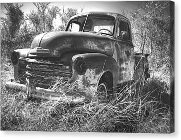 Chevy In A Field Canvas Print by Paul Huchton