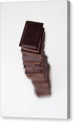 Chocolates Stacked Into Tower Canvas Print by Asia Images