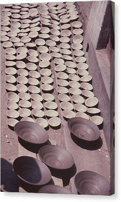 Clay Yogurt Cups Drying In The Sun Canvas Print by David Sherman
