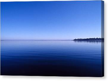 Clear Blue Sky Reflected In A Still Canvas Print by Jason Edwards