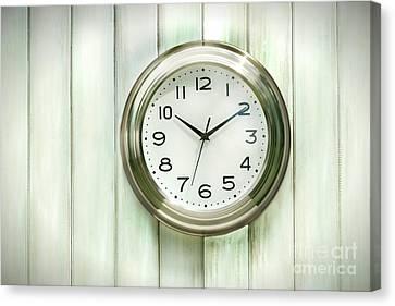Clock On The Wall Canvas Print by Sandra Cunningham