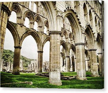 Cloisters Of Rievaulx Abbey Canvas Print by Sarah Couzens