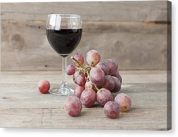 Close Up Of Grapes And Glass Of Wine Canvas Print by Stefanie Grewel