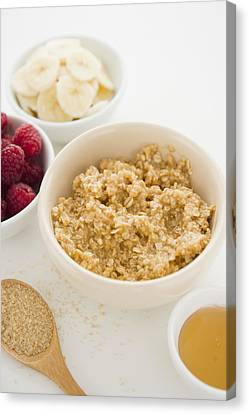 Close Up Of Oats And Fruits In Bowls, Studio Shot Canvas Print by Jamie Grill