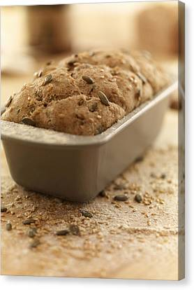 Close Up Of Rustic Bread In Loaf Pan Canvas Print by Adam Gault
