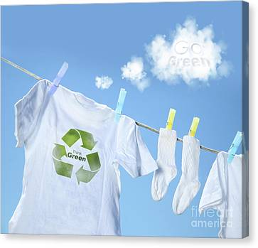 Clothes Drying On Clothesline With Go Green Sign  Canvas Print by Sandra Cunningham