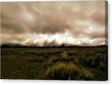 Clouds Over The Tetons Canvas Print by Ellen Heaverlo