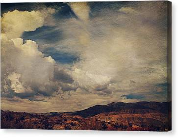 Clouds Please Carry Me Away Canvas Print by Laurie Search
