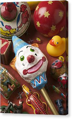 Clown Rattle And Old Toys Canvas Print by Garry Gay