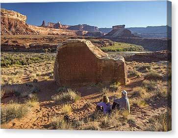 Contemplating The Petroglyphs Canvas Print by Tim Grams