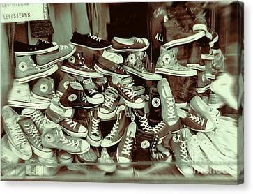 Converse Running Shoe In Window Canvas Print by Helen  Bobis