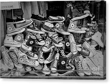 Converse Running Shoes Canvas Print by Helen  Bobis