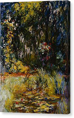 Corner Of A Pond With Waterlilies Canvas Print by Claude Monet