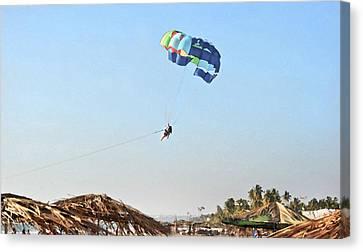 Couple Parasailing Over Shacks Goa Canvas Print by Kantilal Patel