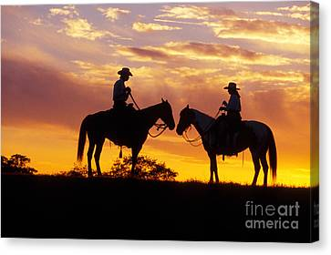 Cowboy And Cowgirl Canvas Print by Ron Sanford and Photo Researchers