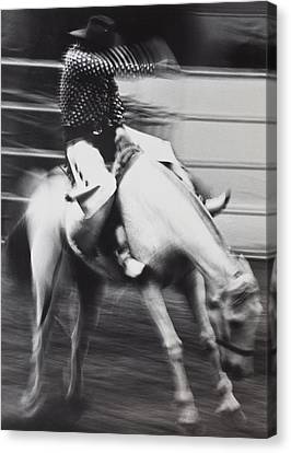 Cowboy Riding Bucking Horse  Canvas Print by Garry Gay