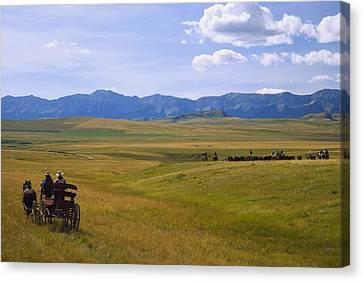 Cowboys And Wagon On A Cattle Drive Canvas Print by Carson Ganci