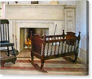 Cradle Near Fireplace Canvas Print by Susan Savad