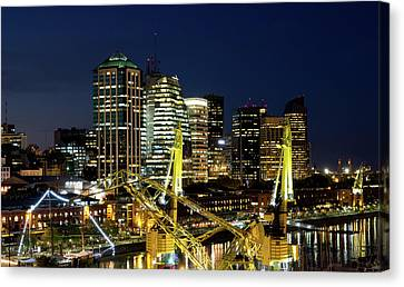 Cranes And Building At Night In Puerto Madero Canvas Print by Photo by Jim Boud