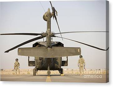 Crew Chiefs Stand Beside Their Uh-60l Canvas Print by Terry Moore