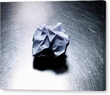 Crumpled Sheet Of White Paper On Stainless Steel. Canvas Print by Ballyscanlon
