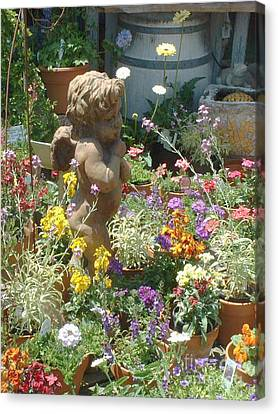 Cupid And A Mixed Bouquet Canvas Print by Joan  Jones