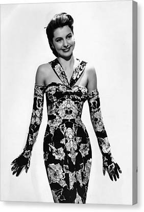 Cyd Charisse Modeling Flowered Evening Canvas Print by Everett