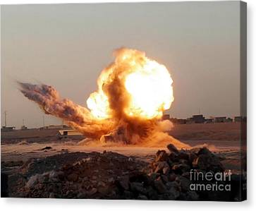 Detonation Of A Weapons Cache Canvas Print by Stocktrek Images