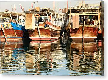 Dhow Reflections Canvas Print by Paul Cowan