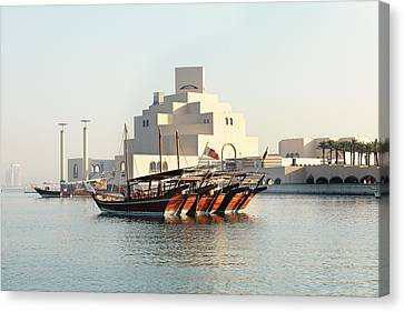 Dhows And Museum Canvas Print by Paul Cowan