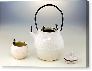 Diving On Tea Pot And Cup Canvas Print by Paul Ge