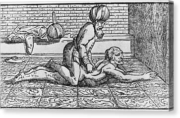 Doctor Massaging A Patients Back Canvas Print by Everett