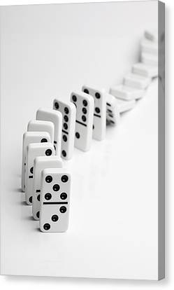 Dominoes Falling Over In A Chain Reaction Canvas Print by Larry Washburn