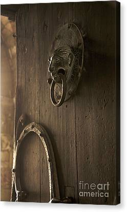 Door Knocker Of The Basilica Saint-julien. Brioude. Haute Loire. Auvergne. France. Canvas Print by Bernard Jaubert