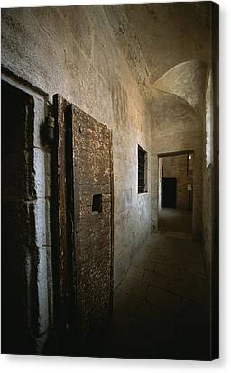 Doors To Cells Along A Hallway Canvas Print by Todd Gipstein