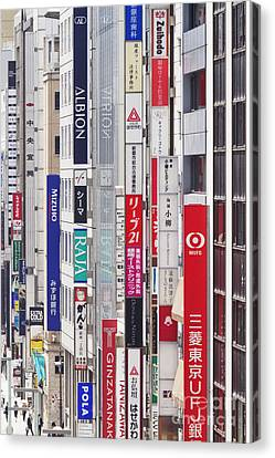 Downtown Business District In Japan Canvas Print by Jeremy Woodhouse