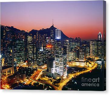 Downtown Hong Kong At Dusk Canvas Print by Jeremy Woodhouse