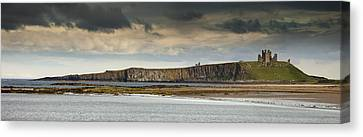 Dunstanburgh Castle On A Hill Under A Canvas Print by John Short