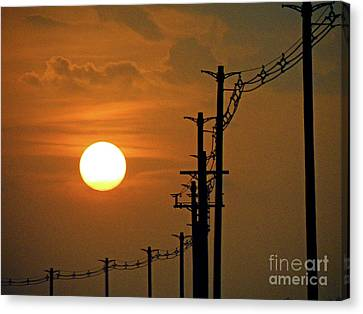 Dusk With Poles Canvas Print by Joe Jake Pratt