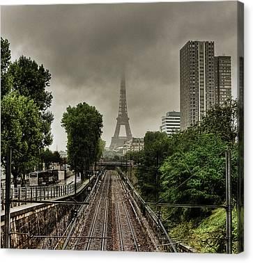 Eiffel Tower In Clouds Canvas Print by Stéphanie Benjamin