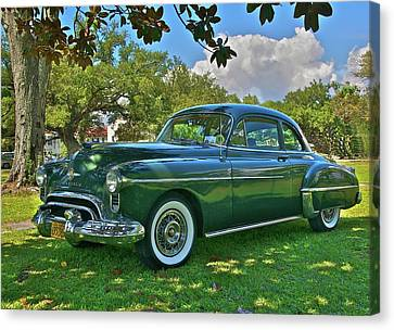 Emerald Oldsmobile Under The Magnolias Canvas Print by Mike  Capone