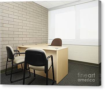 Empty Desk In An Office Canvas Print by Skip Nall